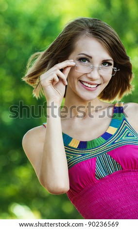 attractive woman pink dress glasses summer park - stock photo