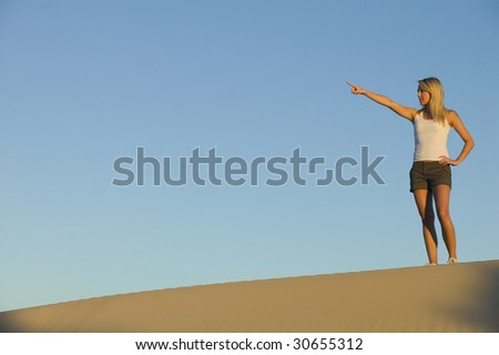 Attractive Woman Pointing to the Distance
