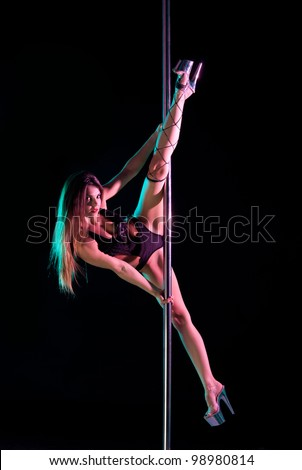 attractive woman pole dancer performing figure