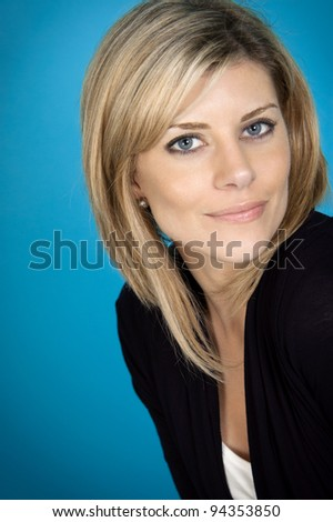 Attractive woman portrait on blue background