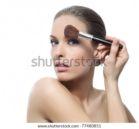 attractive  woman portrait on white background with brush