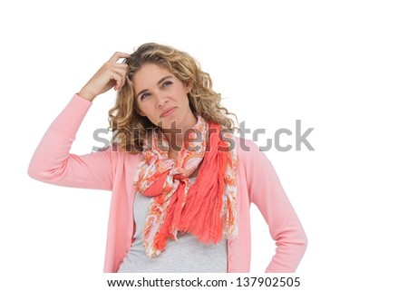 Attractive woman posing and smiling while scratching her head on white background