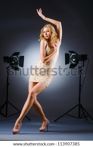 Attractive woman posing in photo studio