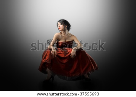 attractive woman seated on armchair