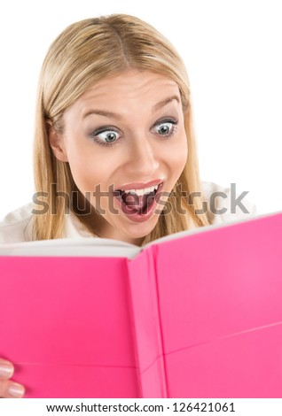 Attractive woman shocked while reading book or diary isolated on white background with copy space