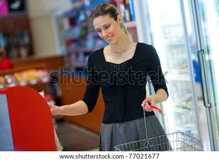 attractive  woman shopping in supermarket store