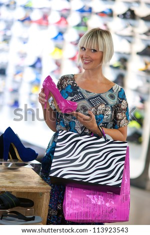 attractive woman shopping shoes in the store