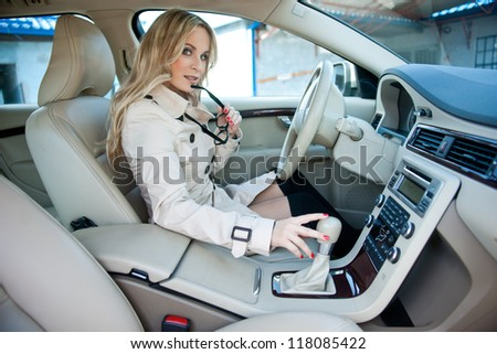 attractive woman sitting in car driver seat