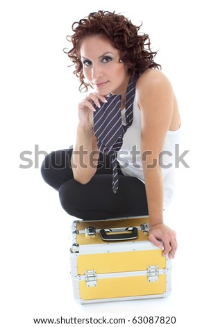 attractive woman sitting with golden toolbox over white