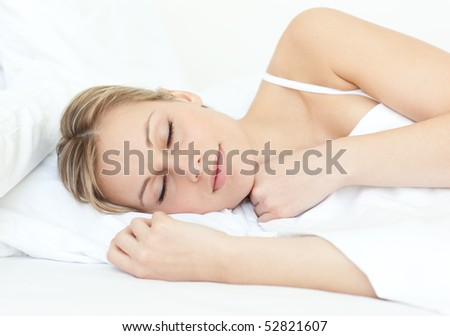 Attractive woman sleeping on a bed at home
