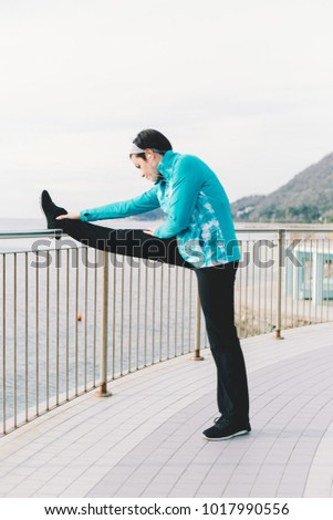 Attractive woman stretching before Fitness and Exercise. Beautiful smiling young athlete woman working out. Fitness concept