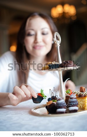 Attractive Woman taking desserts