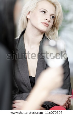 attractive woman waiting for someone at a wine bar.