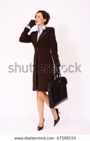 Attractive woman walking with the briefcase
