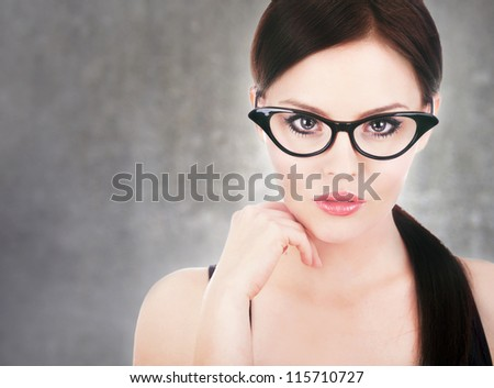 Attractive woman wearing glasses - stock photo