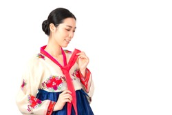 Attractive Woman wearing traditional korean dress, Hanbok. Women wearing traditional Korean hanbok traditional dress. Women wearing traditional korean dress (Hanbok) isolated on white background.