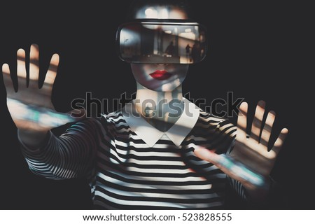 Attractive woman wearing virtual reality goggles. VR headset. Unusual double exposure virtual reality concept.