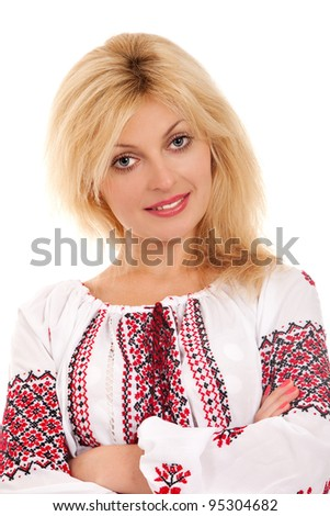 Attractive woman wears Ukrainian national dress isolated on a white background - stock photo