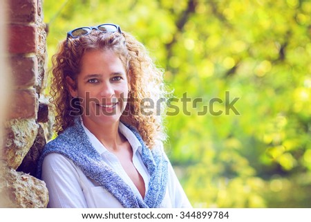 Attractive woman with a friendly smile #344899784