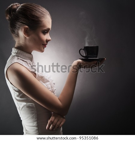 Attractive woman with an aromatic coffee in hands