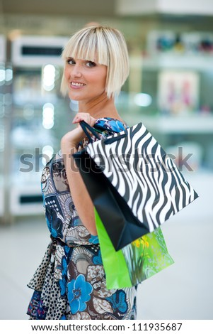 attractive woman with bags at the shopping mall