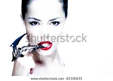 attractive woman with blade metal claw, studio shot - stock photo