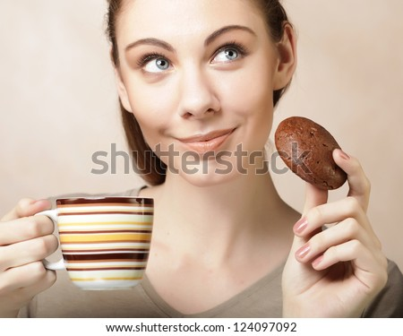 attractive woman with coffee and cookies
