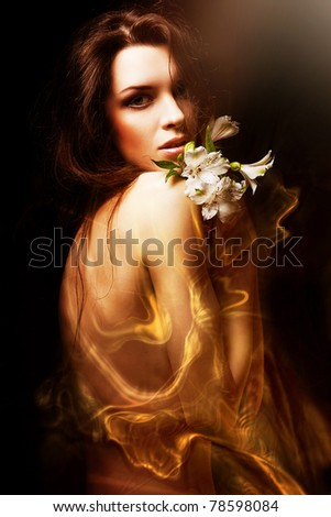 attractive woman with flowers and honey