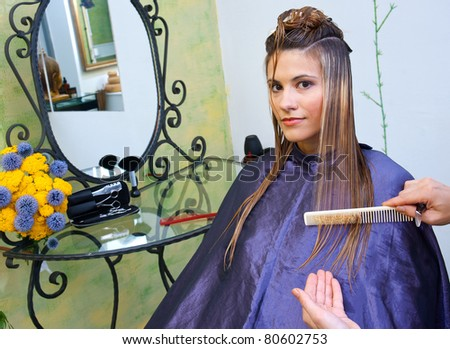 attractive woman with hair full of shampoo foam in salon