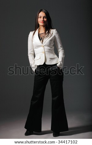 Attractive woman with her hands in one's pockets