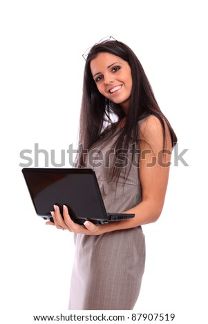 attractive woman with laptop in hands smiling - stock photo