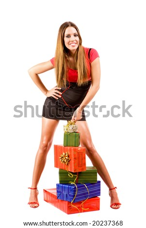 Attractive woman with many colorful gift boxes.