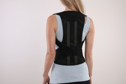 Attractive Woman with Posture Corrector. Scoliosis, Kyphosis treatmentt