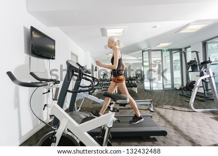 Attractive woman working out in gym