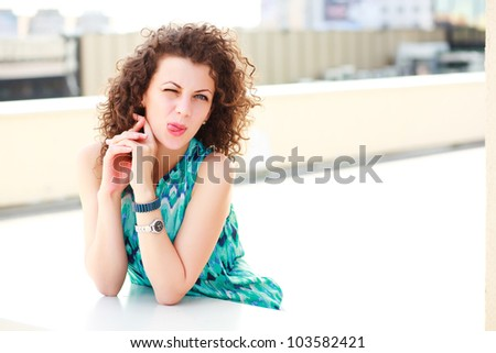 attractive women making a funny face outdoor on a sunny day