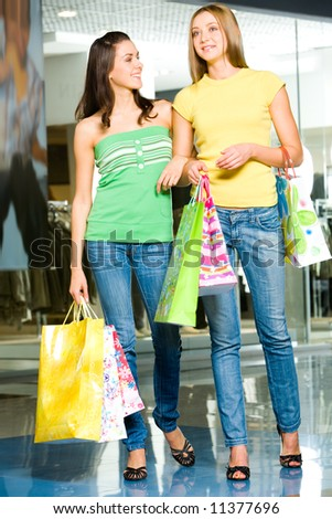 Attractive women standing in the shopping mall