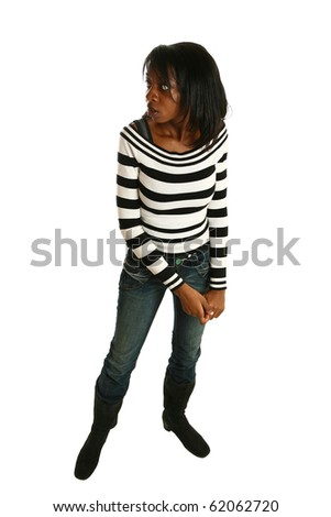 Attractive 20 year old African American woman standing, looking behind herself scared, over white.