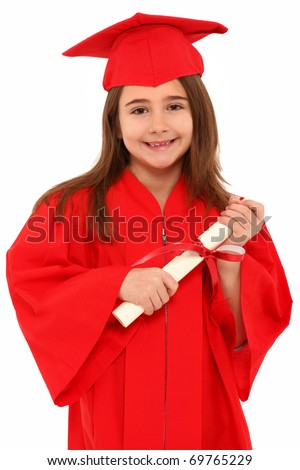 Attractive 7 year old girl in oversized large red graduation cap and gown with diploma over white.