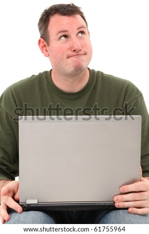 Attractive 35 year old man sitting and thinking over white background with laptop.