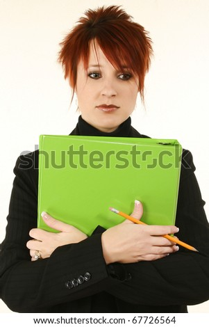 Attractive 30 year old teacher or business woman with green binder serious expression.