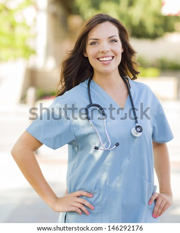 Attractive Young Adult Woman Doctor or Nurse Portrait Outside.
