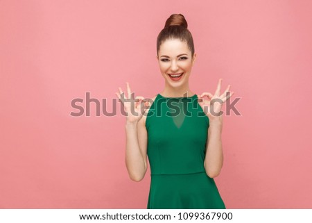 Attractive young adult woman showing ok sign. Expression emotion and feelings concept. Studio shot, isolated on pink background #1099367900