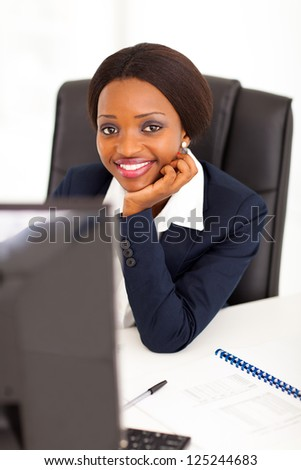 attractive young african american corporate worker in office