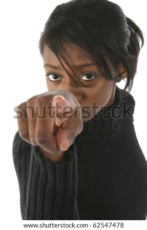 Attractive young african american woman pointing into camera over white background.