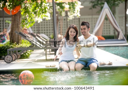 Attractive Young Asian Couple at a resort