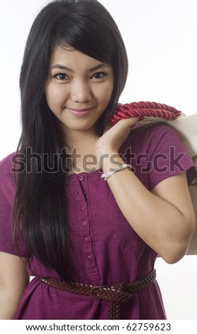 Attractive young Asian girl with shopping bags