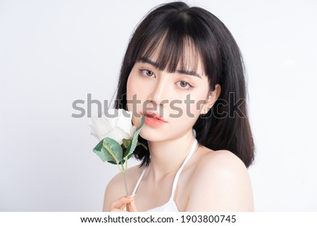 Attractive young Asian woman with fresh skin. Face care, facial treatment, , woman beauty skin isolated on white background. cosmetology, beauty skin and cosmetic concept