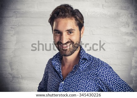Attractive young bearded man laughing #345430226