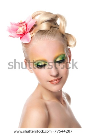 attractive young beautiful natural model woman with orchid flower on head with hairstyle and eye makeup isolated over white background. Spring, summer girl, concept of healthy lifestyle metaphor