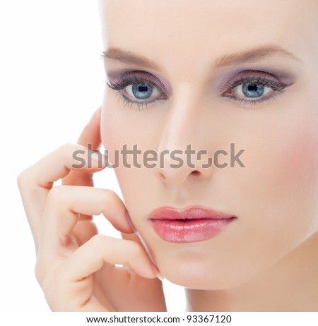 Attractive young beautiful woman looking out of the camera on white background